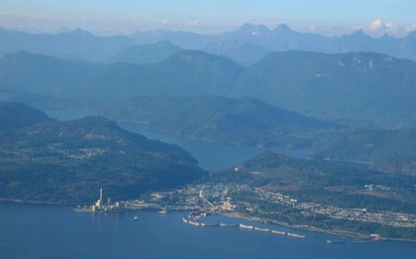 The town of Powell River, British Columbia. The pulp mill is at the left, with the original townsite on the hill above the Mill. Stretching to the south on the right were later additions of the 1920's. A further, more modern extension of the town continues to the right, out of the picture. The mountains of the Coast Range rise to the east behind the town.Mill and townsite of Powell River from the air by James Blake. AirPhoto courtesy Wikipedia Commons