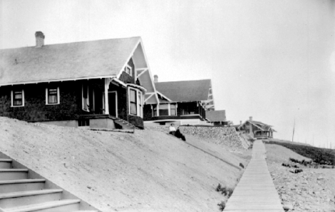 Newly constructed bungalows in Powell River with front porches overlooking the ocean, c1920's. These brown shingled houses were typical of the 'California Bungalow' style popular at the time.