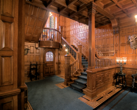 The interior of Craigdarroch features this prefabricated oak staircase from Chicago, which rises through five floors to the tower at the top of the house.