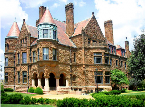 The Cupples Mansion forms part of the St. Louis University Museums. The Mansion displays several architectural elements typical of Richardson Romanesque style residences: A tower and semi-tower; rough stonework, an irregular plan, giving rise to a picturesque roofline of gables, dormers and chimneys; and squat short columns supporting the entrance porch. The forty-four room home was built in 1888 – 1890 and was designed by architect Thomas B. Annan.