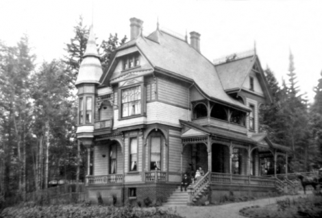'Roslyn' an 1890 pattern book house in Victoria, B.C.  Queen Anne elements include the tower; fancy-cut shingles applied in horizontal bands; inset balconies; other verandas and extensive turned woodwork. The original paint scheme served to accentuate the various building elements. Each different material was a different colour.   This wonderful Queen Anne house has counterparts in Jacksonville; and Brookville, Ohio; as several contractors used the same mail-order plans to build matching homes across the continent. (We would like to hear of any more houses that were built to these plans.  Please contact editor@oldhousehistory.com if you know of any other houses built to similar plans. Thank you!)