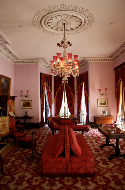 The Drawing Room at Dundurn Castle, Hamilton Ontario. The exuberant                                     plasterwork is typical of the Italianate style, as is the formal placement of                                     furniture and the heavy draperies. This house is open to the public. See:                                                                                                                         http://www.hamilton.ca/CultureandRecreation/Arts_Culture_And_Museums/HamiltonCi            vicMuse            ums/Dundurn/Dundurn_Castle.htm